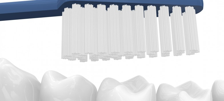 Close-up of a toothbrush in a human mouth